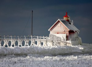 The recent polar vortex left the Grand Haven lighthouse (and many others around the Great Lakes) encased in ice, (Photo by Cory Morse - Grand Rapids Press)
